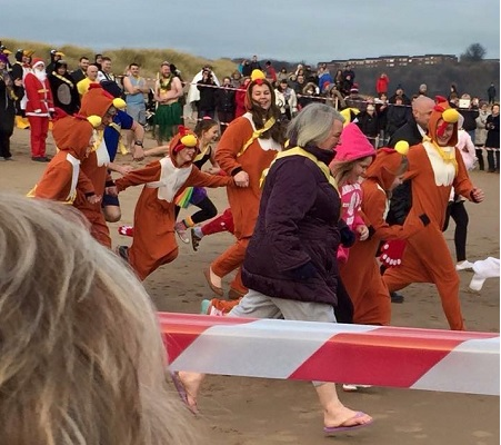 Boxing Day Dip - into the sea in fancy dress